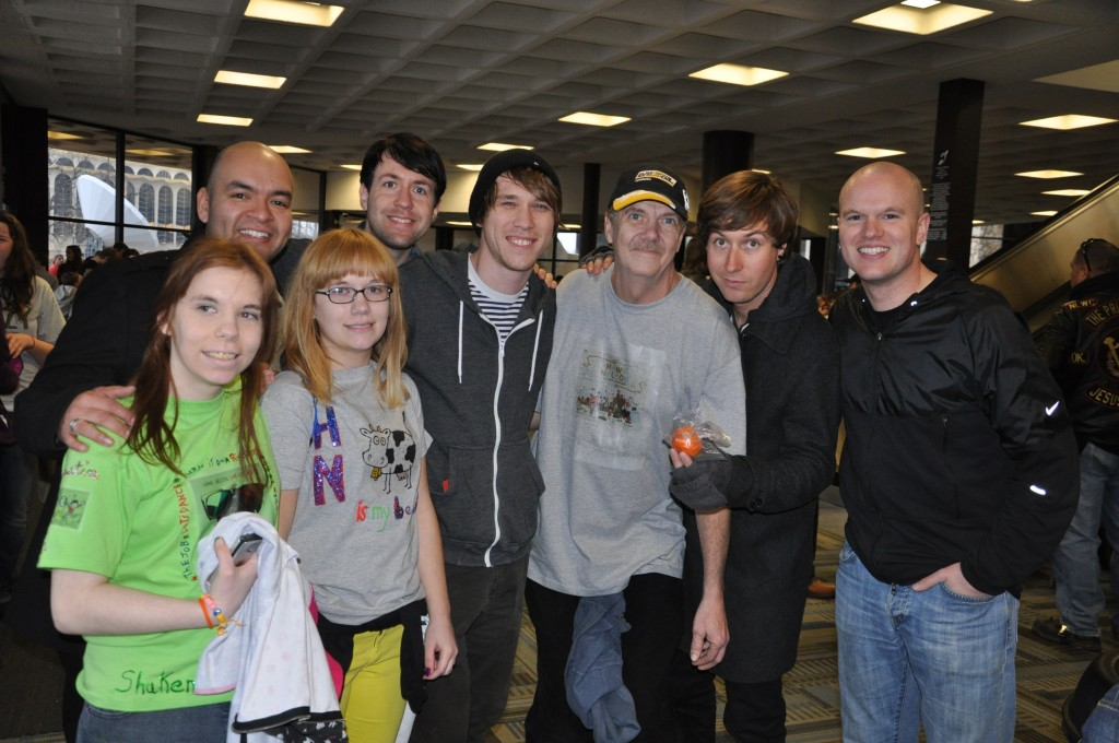 Posing for a photo with Hawk Nelson