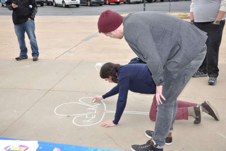 Rend Collective playing with the sidewalk chalk