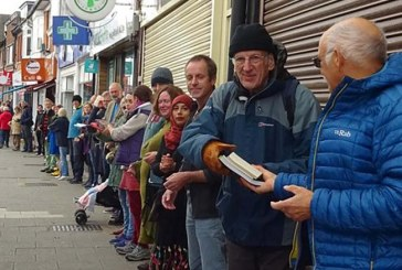 250 People Relocated an Entire Bookstore by Forming a Human Chain