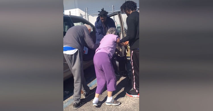 Touching moment of men helping elderly couple into their car!