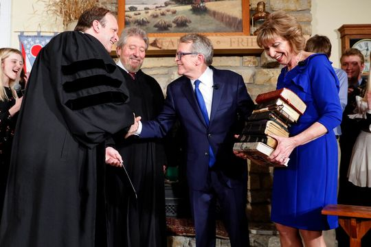 New Ohio Governor uses 9 Bibles for the swearing in